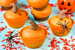 Pumpkin cupcakes for Halloween party. Festive treats for kids co Stock Images