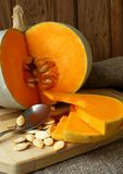 Pumpkin, cut with seeds Royalty Free Stock Image