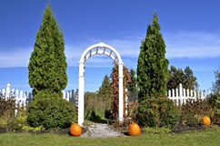 Pumpkin decorated arch into a garden Royalty Free Stock Images