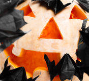 Pumpkin decorated with origami bats Royalty Free Stock Image