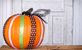 A pumpkin decorated with ribbon Royalty Free Stock Image