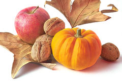 Pumpkin decoration. Pumkin, apples, nuts and leaves Stock Image