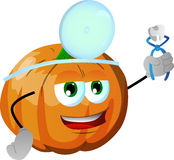 Pumpkin dentist holding teeth Stock Photo