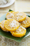 Pumpkin dessert with coconut on banana leaf,thai dessert Stock Photo