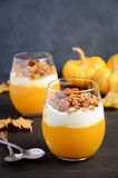 Pumpkin dessert with yogurt and homemade granola on dark wooden table Stock Image