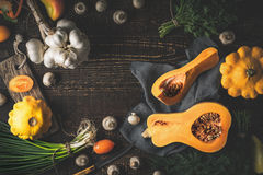 Pumpkin with different vegetables on the old wooden table Royalty Free Stock Images