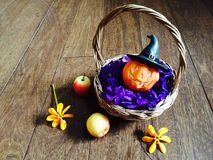 Pumpkin doll in bamboo basket Royalty Free Stock Photography