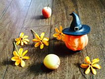 Pumpkin doll and yellow flowers Royalty Free Stock Photos