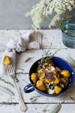 Pumpkin dumplings on cup with thyme and sage on rustic table with flowers Royalty Free Stock Image