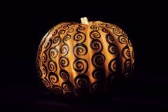 Pumpkin Eclipse. A decorated pumpkin on black studio background stock photos