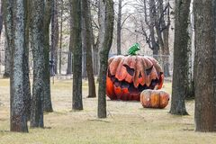 Pumpkin effigy in a summer garden Stock Photo