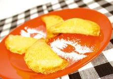 Pumpkin empanada. Pumpkin filled empanada with powdered sugar Stock Photo