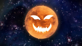 Pumpkin face moon in the space large Royalty Free Stock Image