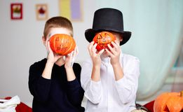 Pumpkin-faced boys Royalty Free Stock Photo