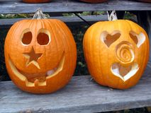 Pumpkin faces. On a park bench - star & heart Stock Photo