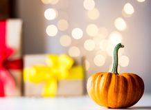 Pumpkin with Fairy Ligths. And bokeh on background royalty free stock photos