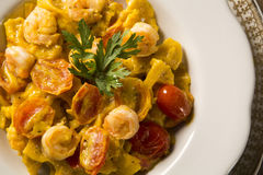 Pumpkin farfalle with shrimp and cherry tomato Royalty Free Stock Photo