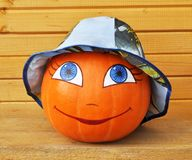 Pumpkin with female face in a panama Stock Images
