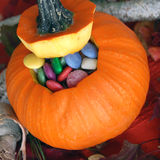 Pumpkin Filled with Candy Royalty Free Stock Photos