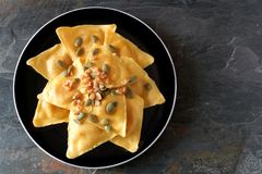 Pumpkin ravioli pasta, overhead on slate Royalty Free Stock Photo
