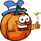 Pumpkin flipping a coin Stock Images
