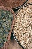 Pumpkin,  flix and sunflower seeds Royalty Free Stock Photo