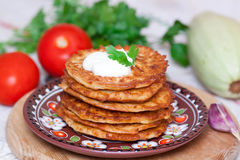 Pumpkin fritters on a plate. With vegetables Stock Photo