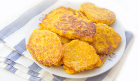 Pumpkin Fritters. On white plate Stock Photography