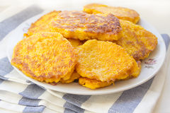 Pumpkin Fritters. On white plate Stock Image