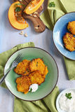 Pumpkin fritters with yogurt sauce Stock Image