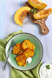 Pumpkin fritters with yogurt sauce. And fresh pumpkin Stock Images