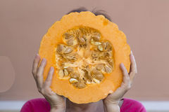 Pumpkin in front of the face Stock Photography