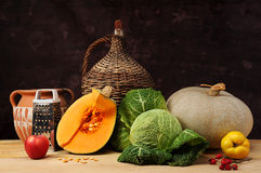 Pumpkin and fruits Stock Images