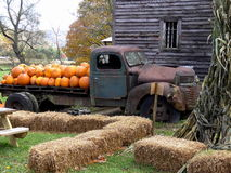 Pumpkin Ghost Truck. Pumpkin Farm  - Appalachian Mountains, North Carolina. Old rusty truck, old tobacco barn, pumpkins, fall trees, hay, and corn stalks Royalty Free Stock Photo