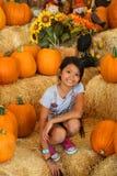 Pumpkin girl Stock Photos