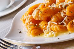 Pumpkin gnocchi with cheese and butter. Horizontal stock images