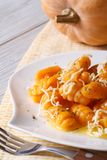Pumpkin gnocchi with cheese on the plate closeup. Vertical royalty free stock photo