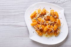 Pumpkin gnocchi with cheese and spices. horizontal top view Stock Photo