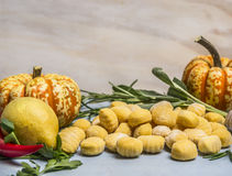 Pumpkin gnocchi with pumpkin pepper lemon herbs  on blue wooden background close up Stock Photo