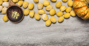 Pumpkin gnocchi on wooden background  with wooden spoon,almonds top view Stock Photography