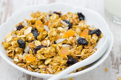 Pumpkin granola with dried fruit and seeds in a bowl closeup Stock Photos