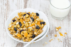 Pumpkin granola with dried fruit and seeds in a bowl top view Stock Photos