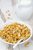 Pumpkin granola and a jug of milk Stock Photo