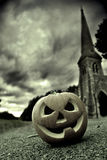 Pumpkin In A Graveyard Stock Image