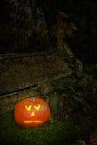 Pumpkin In Graveyard Stock Image