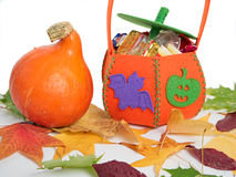 Pumpkin with Halloween bag Royalty Free Stock Photos