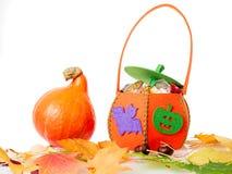 Pumpkin with Halloween bag Stock Photo
