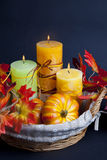 Pumpkin for Halloween with candles in the basket Royalty Free Stock Images