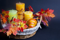 Pumpkin for Halloween with candles in the basket Stock Images