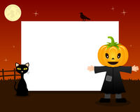 Pumpkin Halloween Horizontal Frame. A Happy Halloween horizontal photo frame with a cute scarecrow with a pumpkin head in a orange night scene background with Stock Images